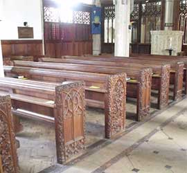 Carved benches, All Saints Church, Holbeton